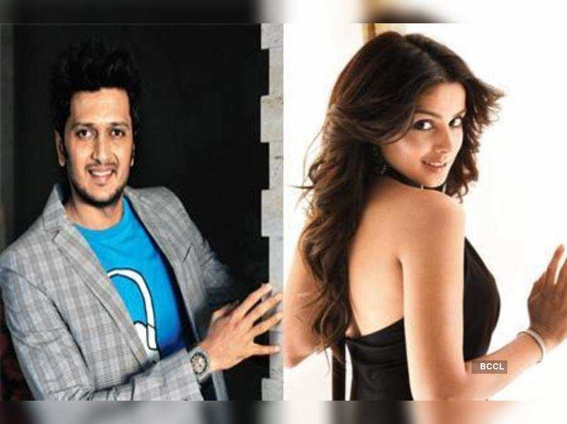 "Riteish Deshmukh and Genelia D'souza  <a href=""http://photogallery.indiatimes.com/celebs/indian-stars/genelia-dsouza/portfoliolist/4560107.cms"" target=""_blank"">More Pics</a>"