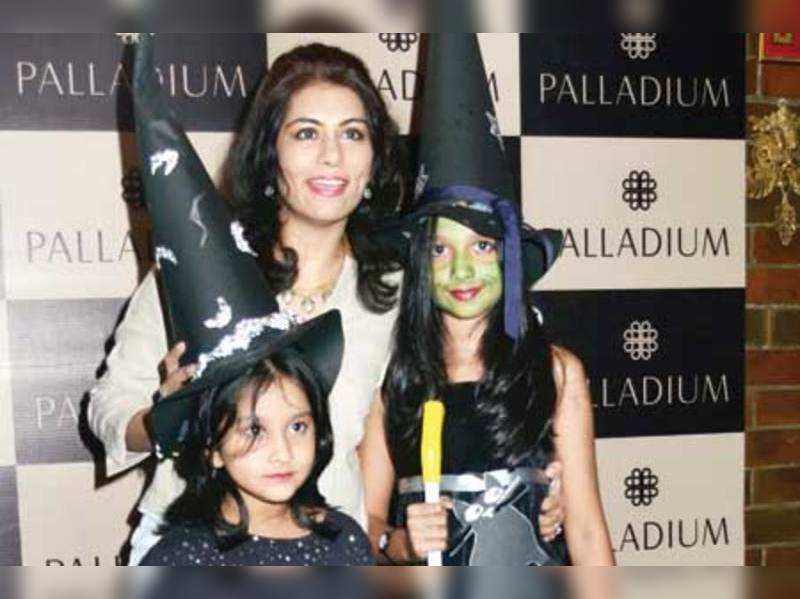 Deepika Gehani poses with the kids who came for the Halloween party