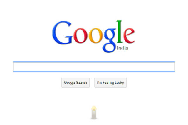 Google India's homepage features a candle just below the search option box with a mouse over text reading 'In memory of the Delhi braveheart'.