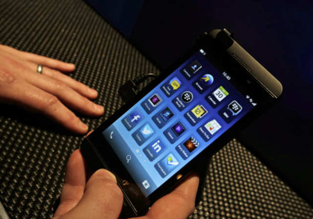 A man holds the new touchscreen BlackBerry Z10 smartphone, during a launch event for the new phone in London, Wednesday, January 30, 2013. (AP photo)