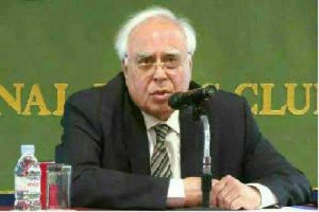 Kapil Sibal has approved a recommendation by DoT for imposing a fine of about Rs 104 crore on Vodafone.