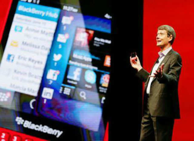 Thorsten Heins, president and CEO at BlackBerry, holds up the new BlackBerry 10 mobile device at a conference on Tuesday in Orlando. (AP Photo)