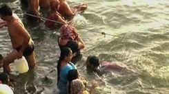 Devotees take holy dip on auspicious day of Akshay Tritiya