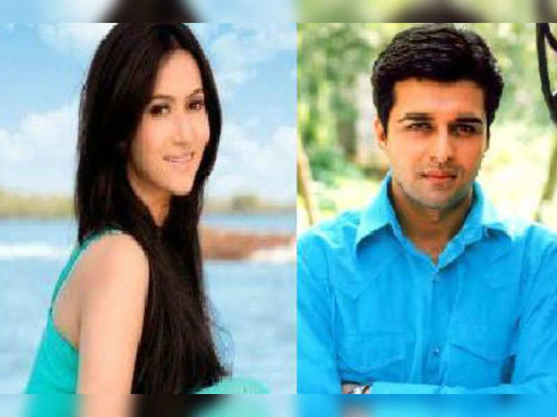 "Rishina Khandhari and Sachin Shroff<a href=""http://photogallery.indiatimes.com/tv/behind-the-scenes/on-the-sets-rishton-ke-bhawar/On-the-sets-Rishton-Ke-Bhawar/articleshow/20147399.cms"" target=""_blank"">More Pics</a>"