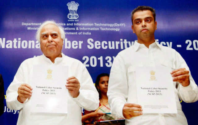 Union minister for communications & information technology Kapil Sibal with MoS for communications and IT Milind Deora releasing the National Cyber Security Policy 2013 in New Delhi on Tuesday. (PTI photo)