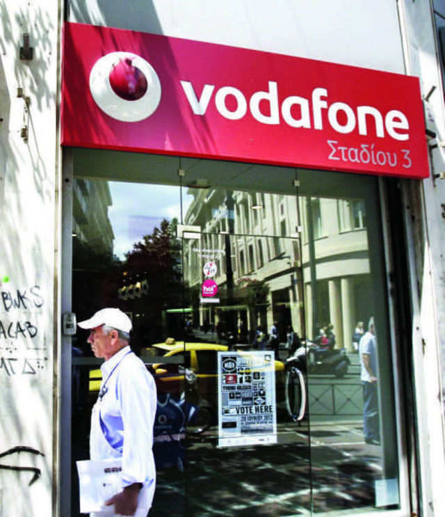 Vodafone has urged telecom minister to ensure new norms be liberal enough to allow operators to hold a miniscule stake in a rival.