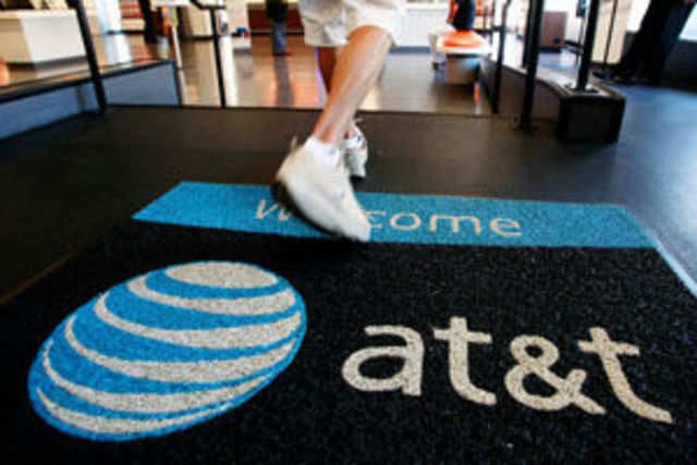 Surge in tablet usage, a trade-in promotion and a fee tacked onto bills helped boost AT&T's wireless revenue.