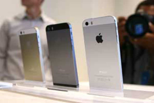 The rush for the latest iPhones has seen the costlier 5S model sold out across the country and retailers asking Apple for emergency replenishments.