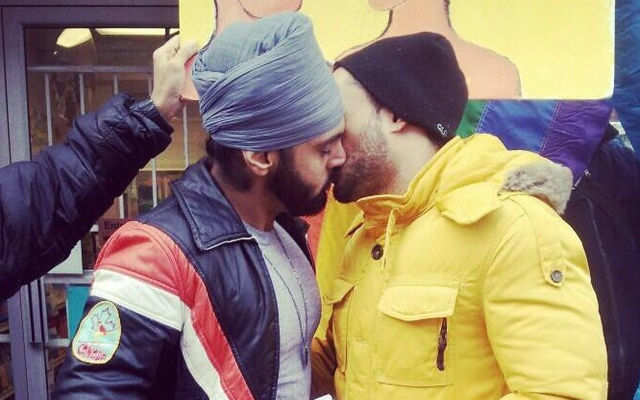 Shahzad Syed Hai and Kanwar Saini aka Sikh Knowledge were photographed kissing on global day of rage in Toronto, Canada. The rally was organized to condemn the Indian Supreme Court's recent decision to recriminalize gay sex.