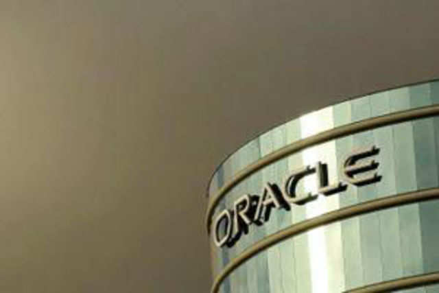 A former Oracle executive sued the company alleging he was fired for complaining about an Indian worker getting lower pay.