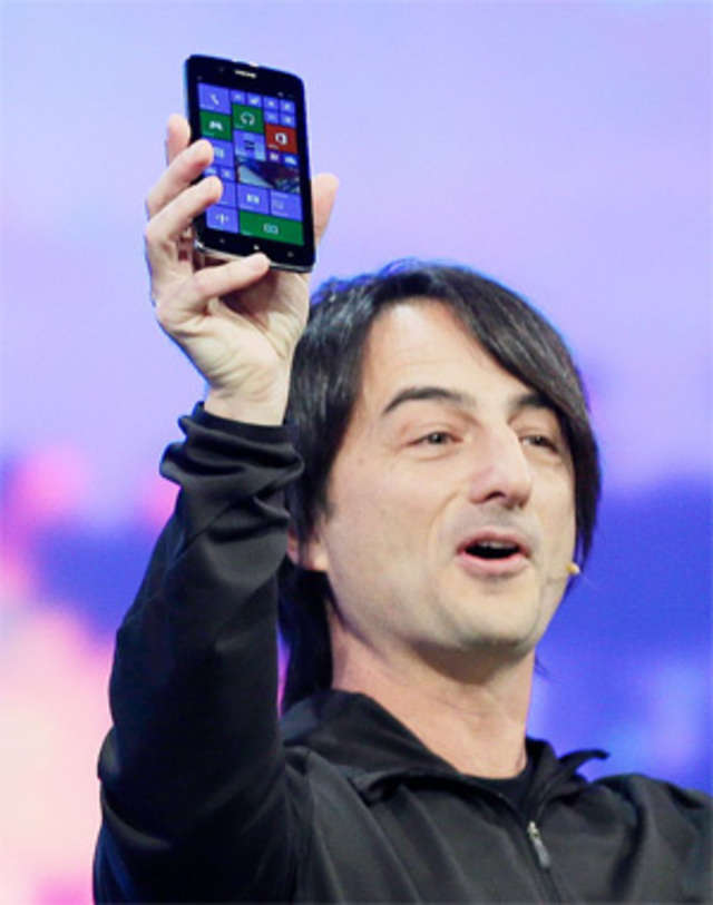 Microsoft corporate vice-president Joe Belfiore, of the Operating Systems Group, holds up a phone using the new Windows 8.1 operating system during the keynote address of the Build Conference on April 2, 2014 in San Francisco. (AP Photo)