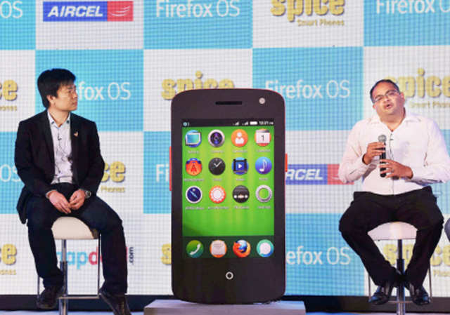 CEO Spice Mobility, Prashant Bindal (R) and senior director Mozilla, James Ho (L) interact with media at the launch of the smartphone in New Delhi.