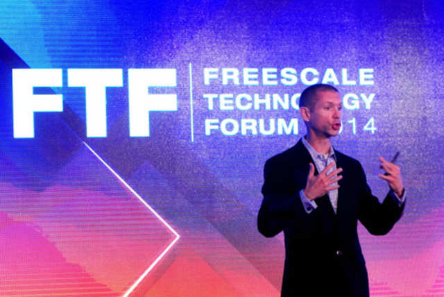 Tom Deitrich, senior vice president and general manager of digital networking, Freescale Semiconductor, delivers a speech during the ninth edition of the 'Freescale Technology Forum 2014' in Bangalore.