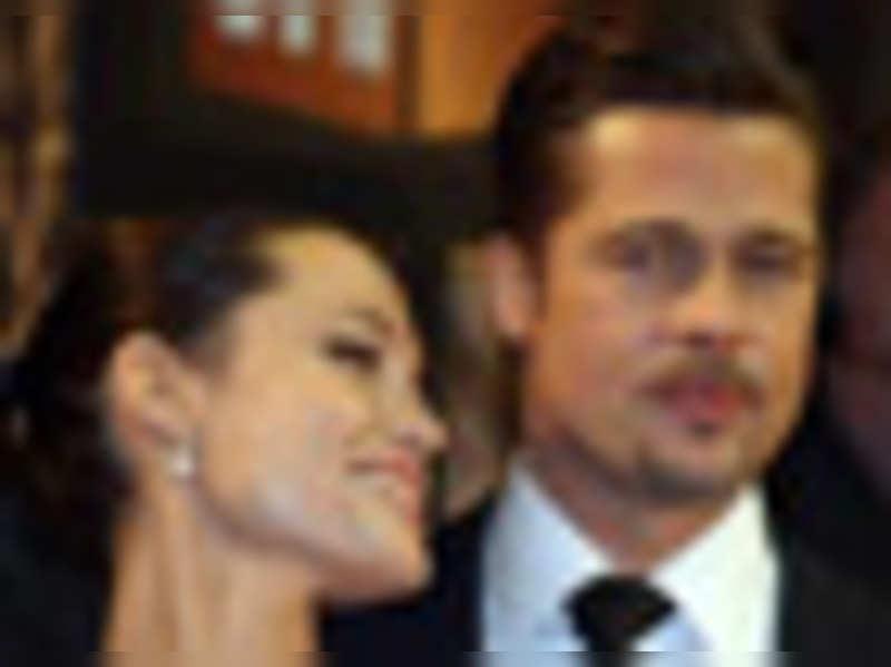 Jolie slaps beau Pitt, sacks nanny