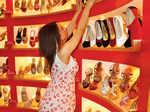 Shanti Dynamite choosing shoes for herself.