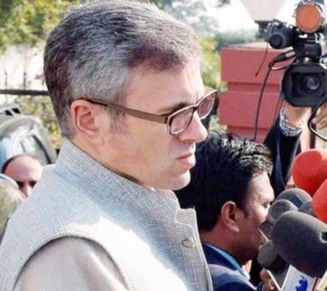 Omar Abdullah interacts with the media soon after submitting his resignation. (PTI Photo)