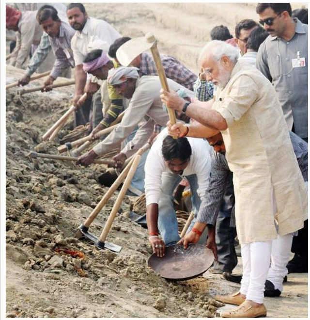 PM Narendra Modi participates in the 'Swachh Bharat Campaign' at Assi Ghat in Varanasi. (PTI file photo)