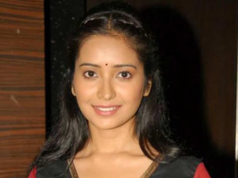 Asha Negi opposite Karan Sharma in a TV show