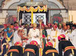 Clad in royal attire of cream silk robes Photogallery - Times of India