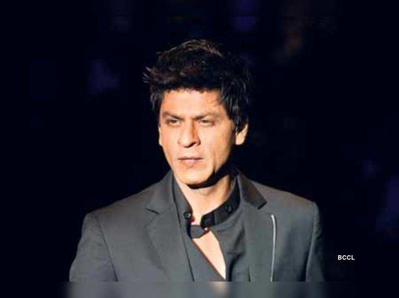 "Shah Rukh Khan <a href=""http://photogallery.indiatimes.com/portfoliolist/3879030.cms"" target=""_blank"">More Pics</a>"
