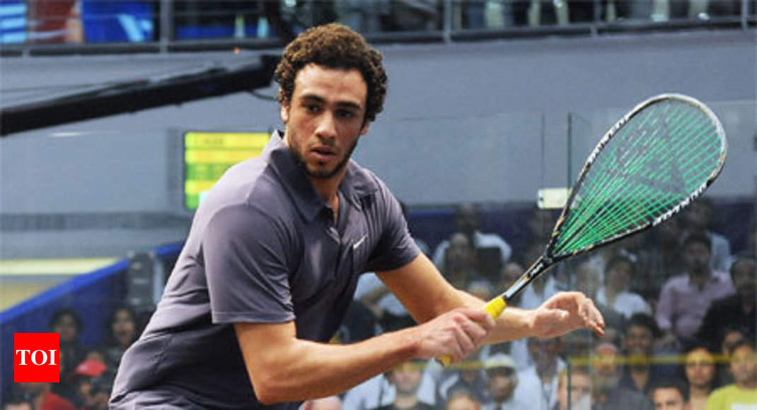ashour saves match point to make british open last
