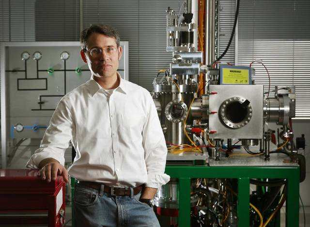 Professor Paul Dastoor with the Scanning Helium Microscope (SHeM), developed at the University of Newcastle.
