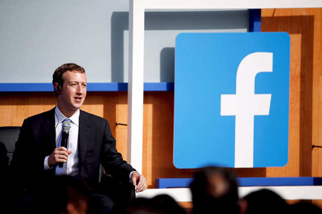 Facebook CEO Mark Zuckerberg puts tape over his laptop's camera