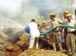 Cops 'rescue' body from burning pyre