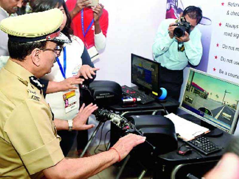 Delhi Police commissioner Alok Kumar Verma at one of the simulation systems which teaches users how to follow traffic rules while driving a two-wheeler (BCCL)