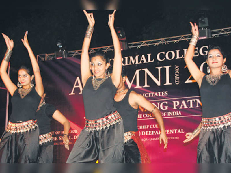 A student performing at the alumni meet