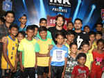 Tiger Shroff poses with children