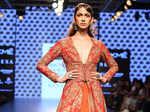 A model showcases a creation by Sonam & Paras Modi