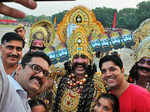 People pose for a selfie with Ramleela artists