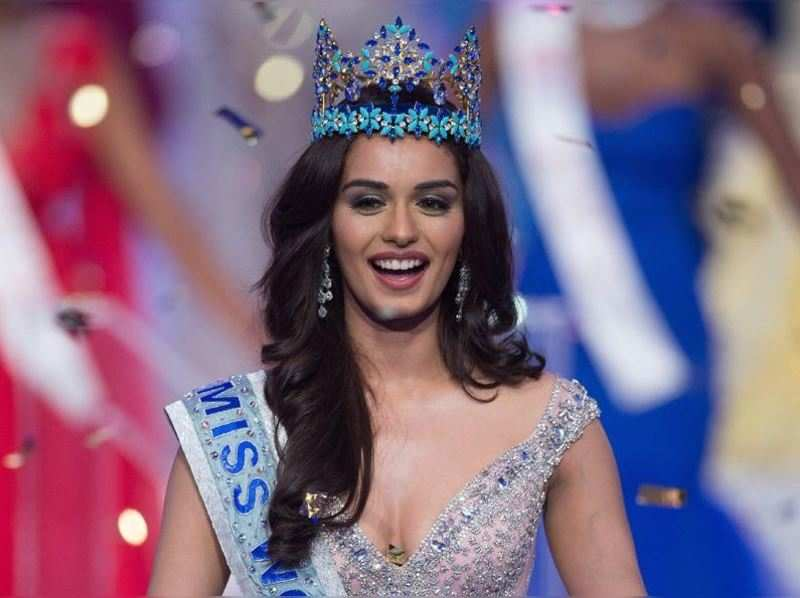 Miss India Manushi Chhilar smiles as she wins the 67th Miss World contest final in Sanya. (AFP photo)