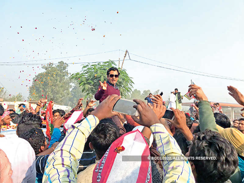 Nawazuddin waves to people who gathered for his road show while campaigning for his sister in law in Budhana (BCCL)