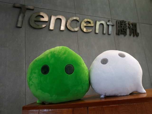 China's tech giants reach global elite with gamers, shoppers Latest update