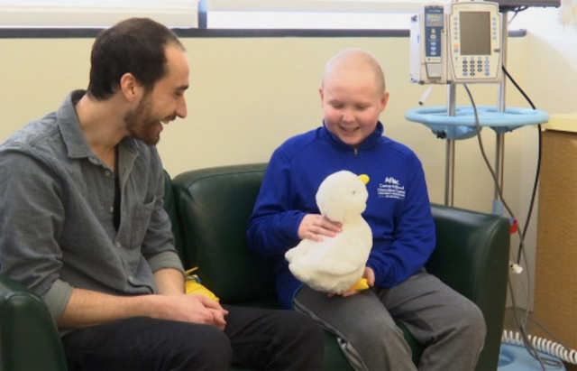 12-year-old cancer patient Ethan Daniels at medical facility in Atlanta speaks with Aaron Horowitz, co-founder and CEO of Sproutel, who designed 'My Special Aflac Duck' to promote emotional well-being by helping children living with cancer develop a sense of control and manage stress through interactive technology.