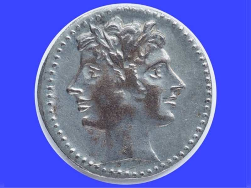 Old Roman coin depicting Janus