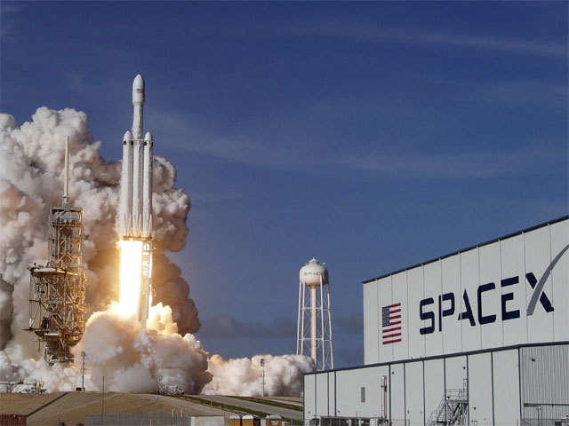 SpaceX's big new rocket blasted off  on its first test flight, carrying a red sports car aiming for an endless road trip past Mars.