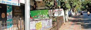 Illegal hoardings pulled down in Sadashiv Peth