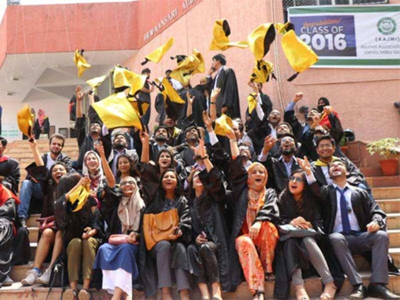 Students cheering after receiving their degrees