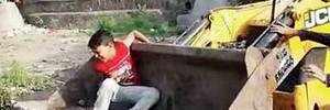 Scared boy in machine bucket, video goes viral