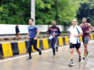 Police officers run for marathon to encourage fitness