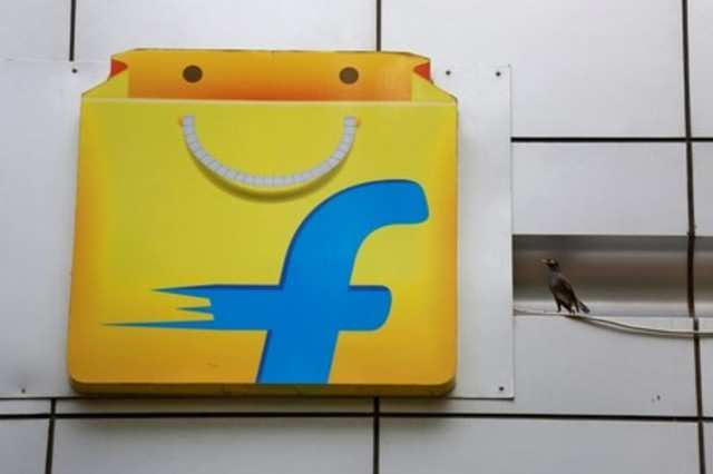 A Common myna sits next to the logo of India's e-commerce firm Flipkart installed on the company's office in Bengaluru, April 12, 2018. REUTERS/Abhishek N. Chinnappa