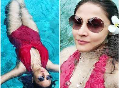 Image result for latest images of Urvashi Dholakia in red bikini dress