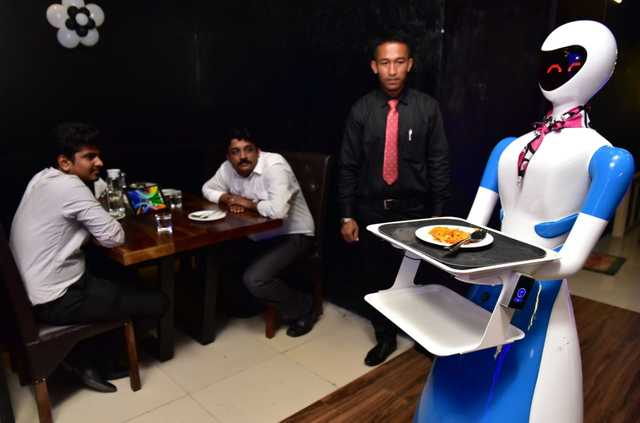 Robots pick up food from the kitchen and deliver it at the customer's table. (TOI photos by J Jackson)