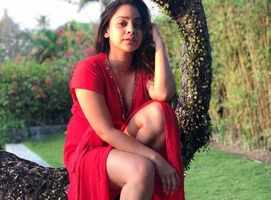 Sumona Chakravarti looks hot in a red outfit