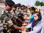 Women tie rakhis to jawans, police personnel