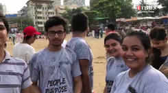 Watch: Students join beach clean-up drive post visarjan