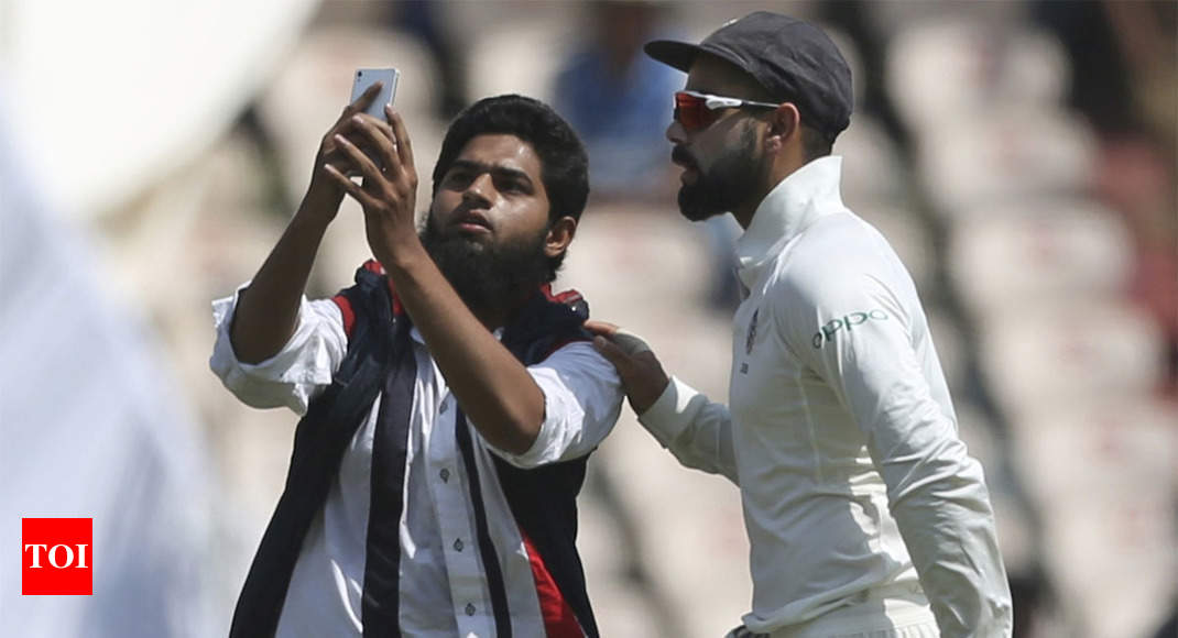 India vs West Indies: Another fan breaks security cordon for selfie with Virat Kohli - Times of India